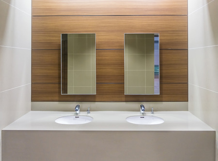 mirror on the water: Mirrors and washbasins in restroom