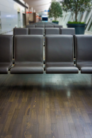 Airport seats for passengers in an airport photo