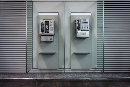 pay wall: Public fixed telephones booth Stock Photo