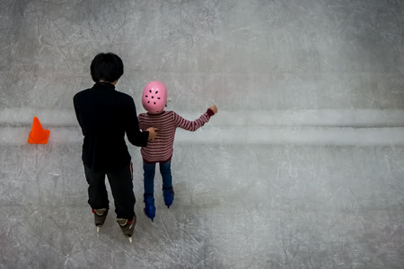 Conceptual image of ice skating coaching in indoor training hall photo