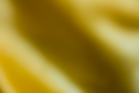 textile image: The blur image of yellow textile curtain