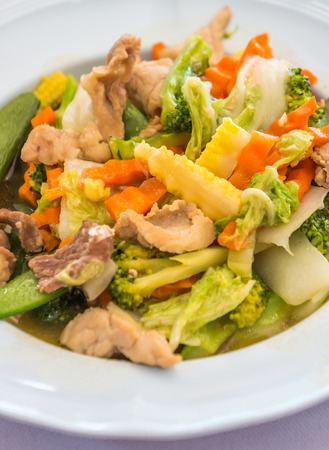 mingle: Stir fried mixed vegetables and pork with Oyster Sauce on white plates