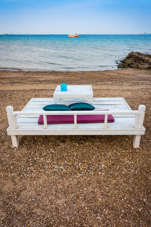 spouse: A couple wooden seat for spouse or family on sand beach