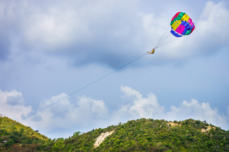towed: Parasail is a parachute that will lift a person up into the air when it is towed by a motorboat