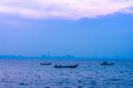 Fishing motorboats at Pattaya bay in the evening photo