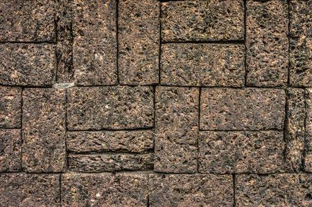 dark brown laterite stone wall photo