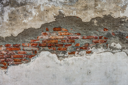 suffusion: The old cracked wall of the abandoned ruins
