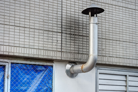 A chimney provides ventilation for hot flue gases to the outside of a building photo