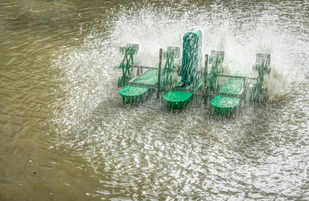 saturation: Water aeration is the process of increasing the oxygen saturation of the water by mechanical surface aerator with buoyancy Stock Photo