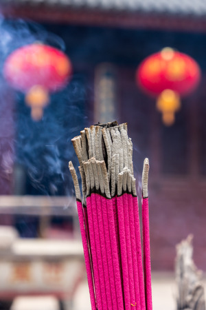 pious: Closeup shot of joss stick in a Chinese temple Stock Photo