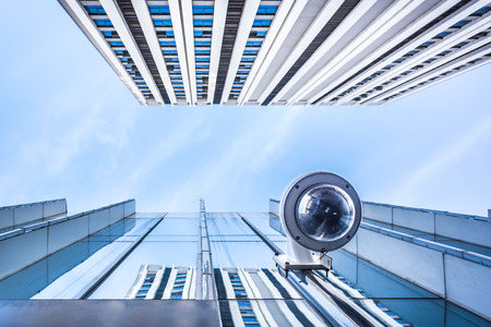 Outdoor Dome Security Camera in a city Stock Photo