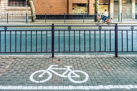 parking lot: Bicycle symbol on bicycle parking lot at roadside in a town of China Stock Photo