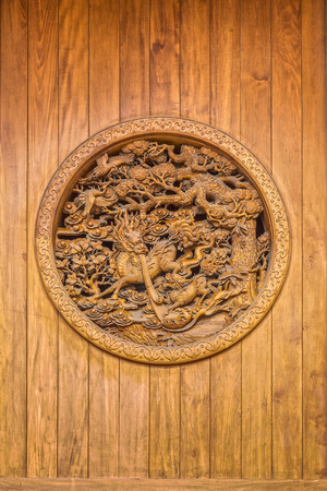 asian art: The interior art of asian literature wall is engraved on wooden wall Stock Photo