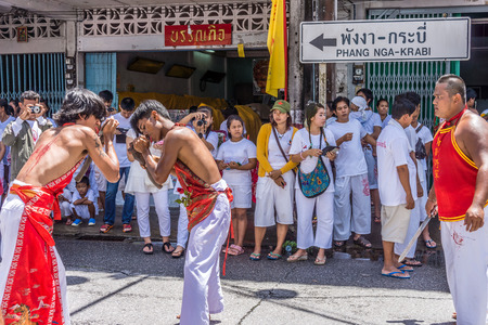 molest: TAKUA PA, PHANG NGATHAILAND - SEPTEMBER 2014: Local people and tourists celebrate a vegetarian festival in Takua Pa. This annual festival takes place from Sept 24 to Oct 2 and Oct 24 to Nov 1, 2014.