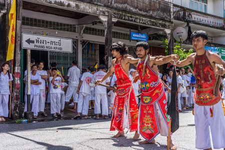god walking: TAKUA PA, PHANG NGATHAILAND - SEPTEMBER 2014: Local people and tourists celebrate a vegetarian festival in Takua Pa. This annual festival takes place from Sept 24 to Oct 2 and Oct 24 to Nov 1, 2014.