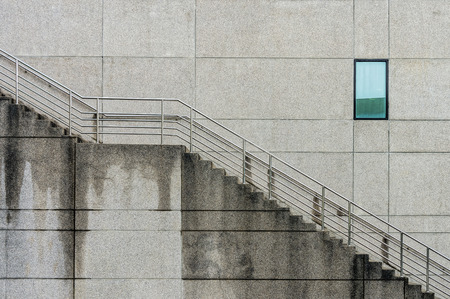Outdoor building with window and concrete staircases