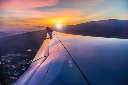 airplane take off: The colorful sunset from an airplane view