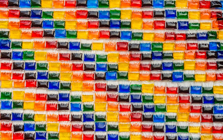 Decoration on the wall with plastic bags of colorful water Stock Photo