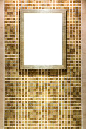 White blank picture frame hanging on the ceramic tiles wall