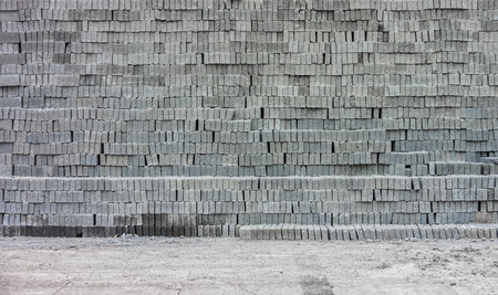 stockpile: Gray concrete blocks on ground for construction materials