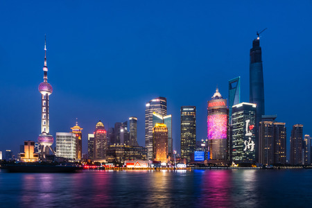 pudong district: SHANGHAI, CHINA - FEBRUARY 2, 2015: Pudong landmarks at night. Pudong is a district of Shanghai, China, located east of the Huangpu River across from the historic city center of Shanghai in Puxi.