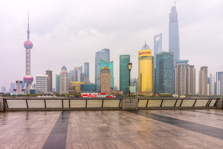 pudong district: SHANGHAI, CHINA - MARCH 28, 2014: Pudong landmarks after rainy day. Pudong is a district of Shanghai, China, located east of the Huangpu River across from the historic city center of Shanghai in Puxi.