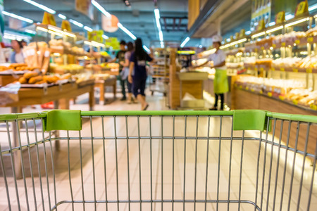 fresh bakery: Shopping with shopping cart in bakery department of supermarket Stock Photo