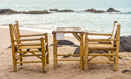 southern of thailand: Bamboo chairs and table on Pak Weep beach in Southern Thailand in the evening Stock Photo