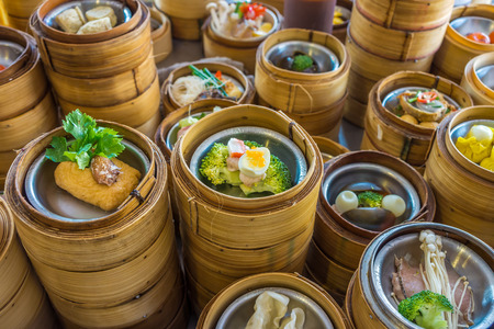 Small steamer baskets of Dim Sum in restaurant Stock Photo