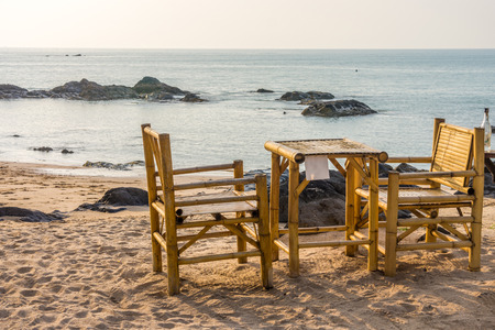 southern thailand: Bamboo chairs and table with clear sky on Pak Weep beach in Southern Thailand in the evening Stock Photo