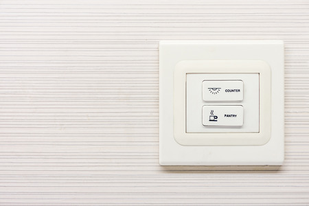Electrical switch buttons on wall for controlling circuits Stock Photo