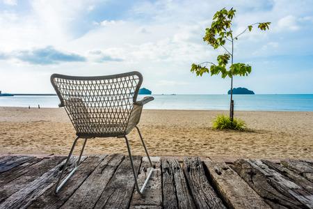 log deck: Khlong Wan beach with silhouette of wicker chair on wooden log deck in Prachuap Khiri Khan province Thailand