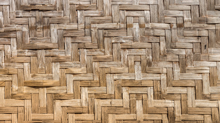 Natural wooden wall is made by bamboo wickerwork of traditional Thai house for interior design Stock Photo