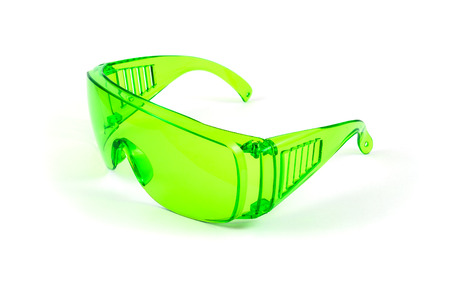 eye protectors: Green plastic protective spectacles isolated on white background Stock Photo