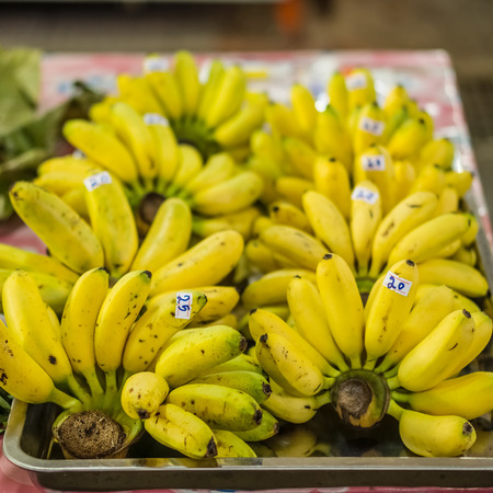 mas: Cluster of Dainty bananas or Pisang Mas for retail sale in Thailand fresh food market Stock Photo