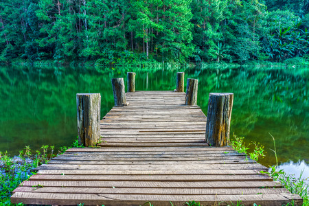tranquil: Tranquil scene of wooden pier in natural Huai Makhuea Som lake. The scene is in tropical forest of Mae Hong Son province, Northern Thailand