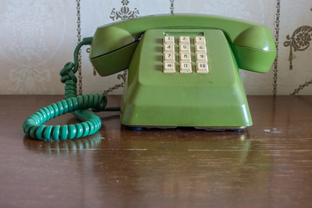 fixed line: Retro traditional fixed-line telephone on wooden table Stock Photo