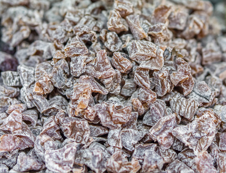 preserves: Heap of dried peach Prunus persica slice for retail sale in Thailand food market. It is fruit preserves for long-term storage. Stock Photo