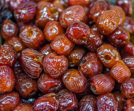 preserves: Heap of dried Chinese date Ziziphus jujuba for retail sale in Thailand food market. It is fruit preserves for long-term storage.