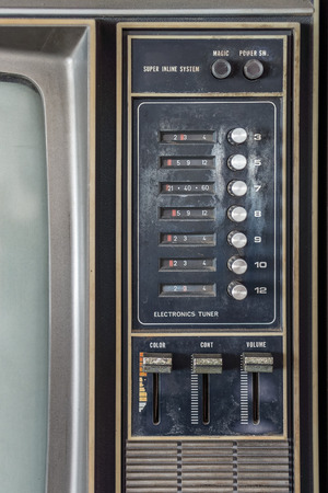 control power: Control panel of old classic color analog television. It has channel selector dials, push power switch and set of volume, color, contrast, brightness adjustment control.
