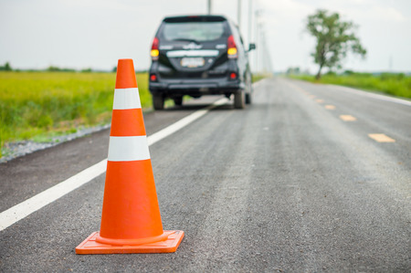 emergency lane: Orange traffic cone on country road. It is used for warning to broken down car on country road, Thailand.