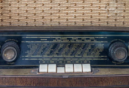 selector: Control panel of old classic analog radio receiver. It has channel selector dials, set of push buttons and letters for display a specific selection.
