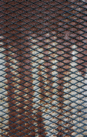 metal grate: Pattern of grate on grunge rusty metal plate for background and texture