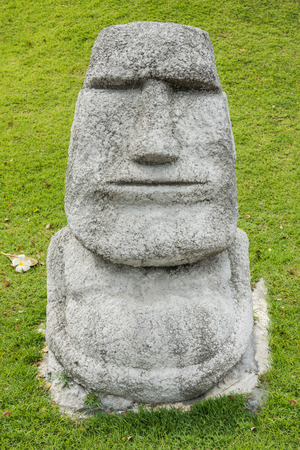 copied: Moai in a garden. The statue is a small copied model. Stock Photo