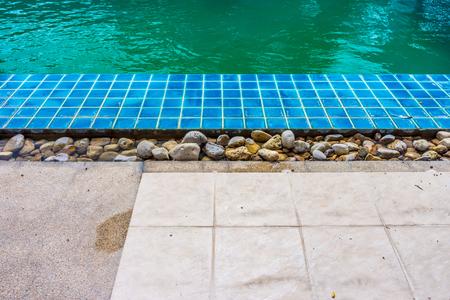 the edge: On the pool edge Stock Photo
