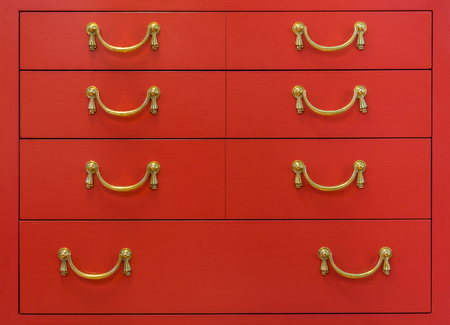 drawers: Vintage red chest of drawers. It is made from wooden.