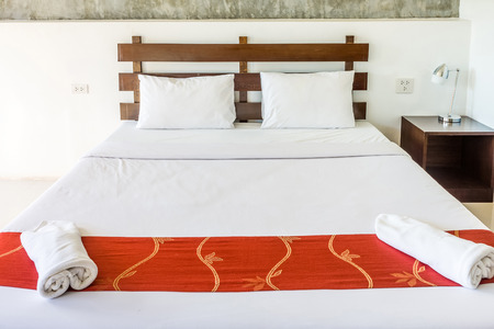 bedsheets: Double bed and furniture for relaxation. The bed room is hotel room.