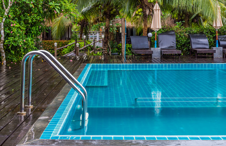 enables: Chrome handrails of swimming pool. This place enables swimming or other leisure activities.