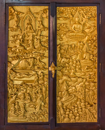 wooden window: Finely carved wooden window in Buddhist temple. Detail of  Buddhas story in Buddhism religion. Stock Photo