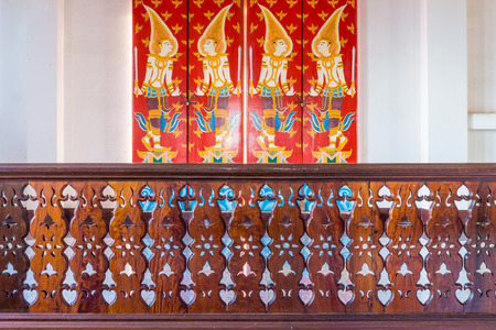 banister: Vintage Thai Pattern and perforated design on wooden banister.  The banister of Buddhist temple is at Wat Nong Waeng in Khon Kaen province, Thailand. Stock Photo